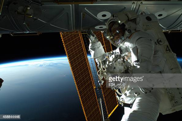 In this handout photo provided by the European Space Agency German ESA astronaut Alexander Gerst takes a photo during his spacewalk whilst aboard the...
