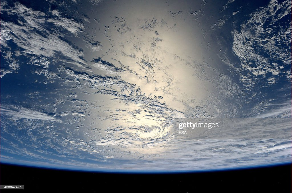 In this handout photo provided by the European Space Agency on July 17 German ESA astronaut Alexander Gerst took this image of the Earth reflecting...