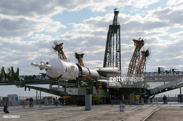 In this handout photo provided by the European Space Agency The Soyuz TMA18M spacecraft is moved into vertical position on launch pad 1 at Baikonur...