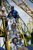 In this handout photo provided by the European Space Agency The Soyuz TMA15 crew of Canadian Space Agency astronaut Robert Thirsk Russian cosmonaut...