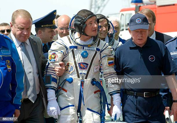 In this handout photo provided by the European Space Agency The Soyuz TMA15 crew member Russian cosmonaut Roman Romanenko arrives during preparations...