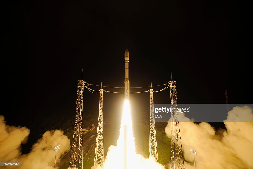 In this handout photo provided by the European Space Agency the Vega launcher carrying LISA Pathfinder takes off from Kourou at 0404 GMT on December...