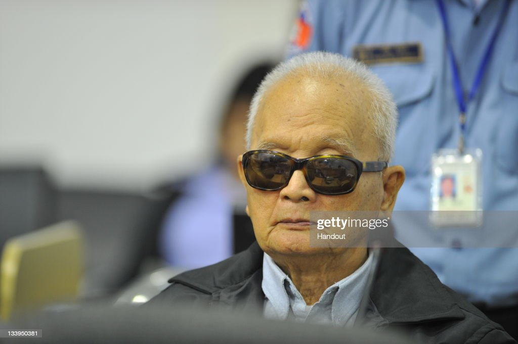In this handout photo provided by the Extraordinary Chambers in the Courts of Cambodia, Former Khmer Rouge official, <a gi-track='captionPersonalityLinkClicked' href=/galleries/search?phrase=Nuon+Chea&family=editorial&specificpeople=767256 ng-click='$event.stopPropagation()'>Nuon Chea</a>, who was deputy to leader Pol Pot, appears in the Extraordinary Chambers in the Courts of Cambodia on the second day of Case 002, on November 22, 2011 in Phnom Penh, Cambodia. Chea, along with former Head of State Khieu Samphan and Foreign Minister Ieng Sary are at trial for genocide at a UN backed court for their role in the death of up to two million Cambodians during the Maoist revolution in the 1970s.