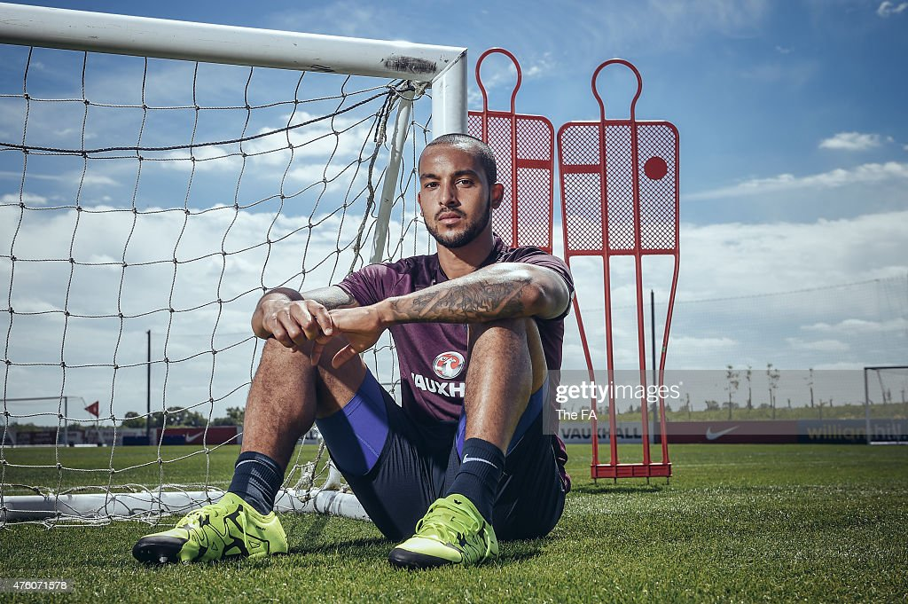 In this handout photo provided by The FA Theo Walcott poses after training at St Georges Park on June 4 2015 in BurtonuponTrent England