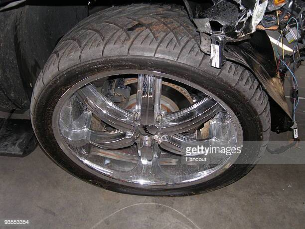 In this handout photo provided by The Florida Highway Patrol a wheel of the vehicle driven by Tiger Woods during his accident is seen on December 2...