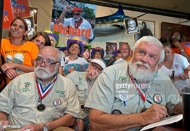 In this handout photo provided by the Florida Keys News Bureau previous Ernest Hemingway lookalike winners including Chris Storm left and John...