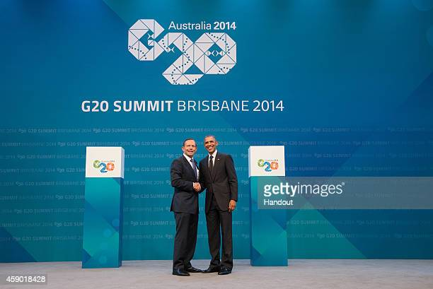 In this handout photo provided by the G20 Australia Australian Prime Minister Tony Abbott greets United States President Barack Obama during the...