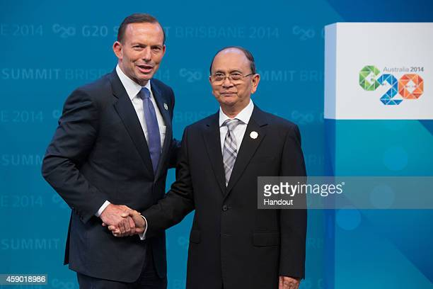 In this handout photo provided by the G20 Australia Australian Prime Minister Tony Abbott greets Myanmar's President U Thein Sein during the official...