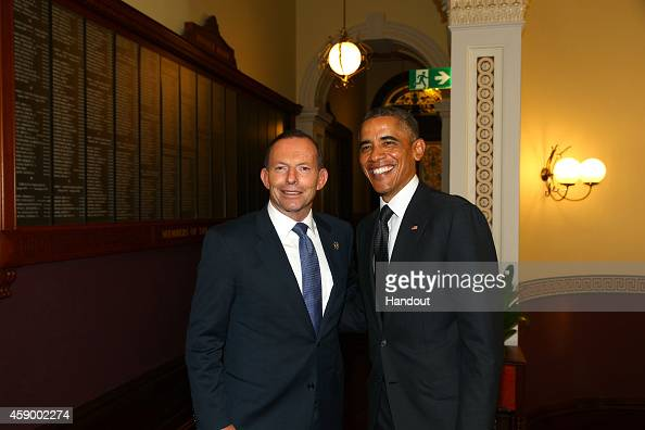 In this handout photo provided by the G20 Australia Australia's Prime Minister Tony Abbott greets United States' President Barack Obama in the...
