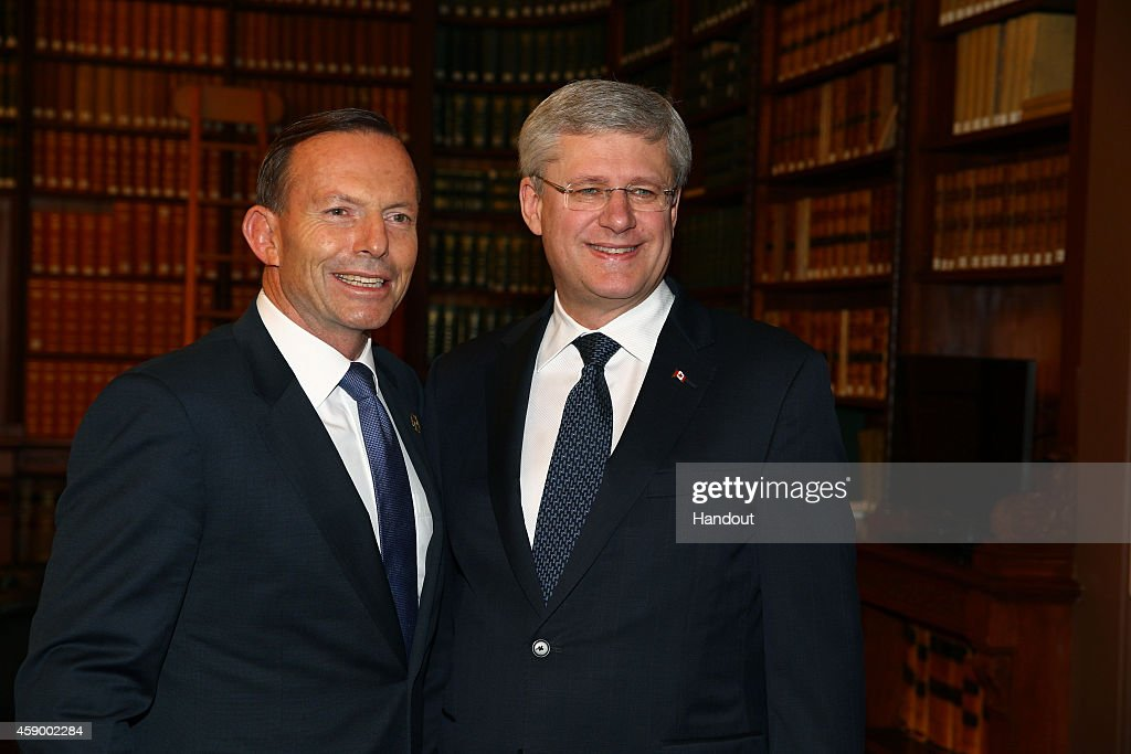 In this handout photo provided by the G20 Australia, Australia's Prime Minister <a gi-track='captionPersonalityLinkClicked' href=/galleries/search?phrase=Tony+Abbott&family=editorial&specificpeople=220956 ng-click='$event.stopPropagation()'>Tony Abbott</a> greets Canada's Prime Minister <a gi-track='captionPersonalityLinkClicked' href=/galleries/search?phrase=Stephen+Harper+-+Politician&family=editorial&specificpeople=690870 ng-click='$event.stopPropagation()'>Stephen Harper</a> in the Reading Room at Parliament House during the G20 Leaders' Summit on November 15, 2014 in Brisbane, Australia. World leaders have gathered in Brisbane for the annual G20 Summit and are expected to discuss economic growth, free trade and climate change as well as pressing issues including the situation in Ukraine and the Ebola crisis.