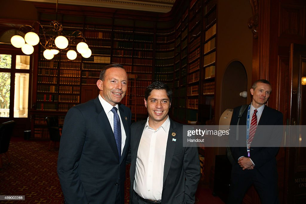 In this handout photo provided by the G20 Australia, Australia's Prime Minister <a gi-track='captionPersonalityLinkClicked' href=/galleries/search?phrase=Tony+Abbott&family=editorial&specificpeople=220956 ng-click='$event.stopPropagation()'>Tony Abbott</a> greets Argentina's Minister of Economy <a gi-track='captionPersonalityLinkClicked' href=/galleries/search?phrase=Axel+Kicillof&family=editorial&specificpeople=9189054 ng-click='$event.stopPropagation()'>Axel Kicillof</a> in the Reading Room at Parliament House during the G20 Leaders' Summit on November 15, 2014 in Brisbane, Australia. World leaders have gathered in Brisbane for the annual G20 Summit and are expected to discuss economic growth, free trade and climate change as well as pressing issues including the situation in Ukraine and the Ebola crisis.