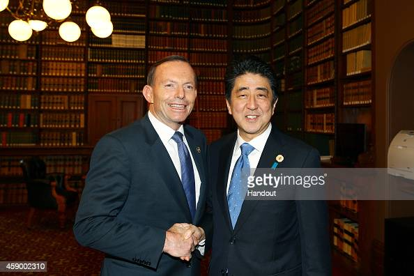 In this handout photo provided by the G20 Australia Australia's Prime Minister Tony Abbott greets Japan's Prime Minister Shinzo Abe in the Reading...
