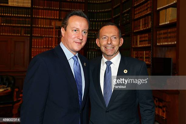 In this handout photo provided by the G20 Australia Australia's Prime Minister Tony Abbott greets United Kingdom's Prime Minister David Cameron in...