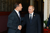 In this handout photo provided by the G20 Australia Australia's Prime Minister Tony Abbott greets Russia's President Vladimir Putin in the Reading...