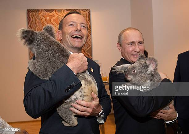 In this handout photo provided by the G20 Australia Australia's Prime Minister Tony Abbott and Russia's President Vladimir Putin meet Jimbelung the...