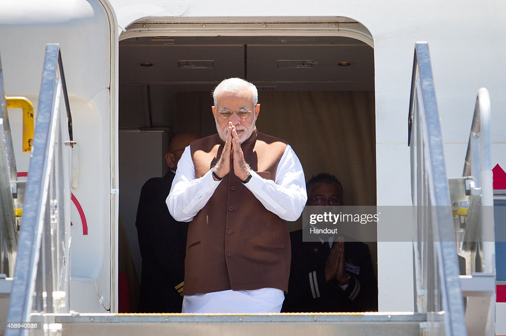 In this handout photo provided by the G20 Australia, Indian Prime Minister Narendra Modi arrives at the Brisbane G20 Terminal on November 14, 2014 in Brisbane, Australia. World leaders have gathered in Brisbane for the annual G20 Summit and are expected to discuss economic growth, free trade and climate change as well as pressing issues including the situation in Ukraine and the Ebola crisis.