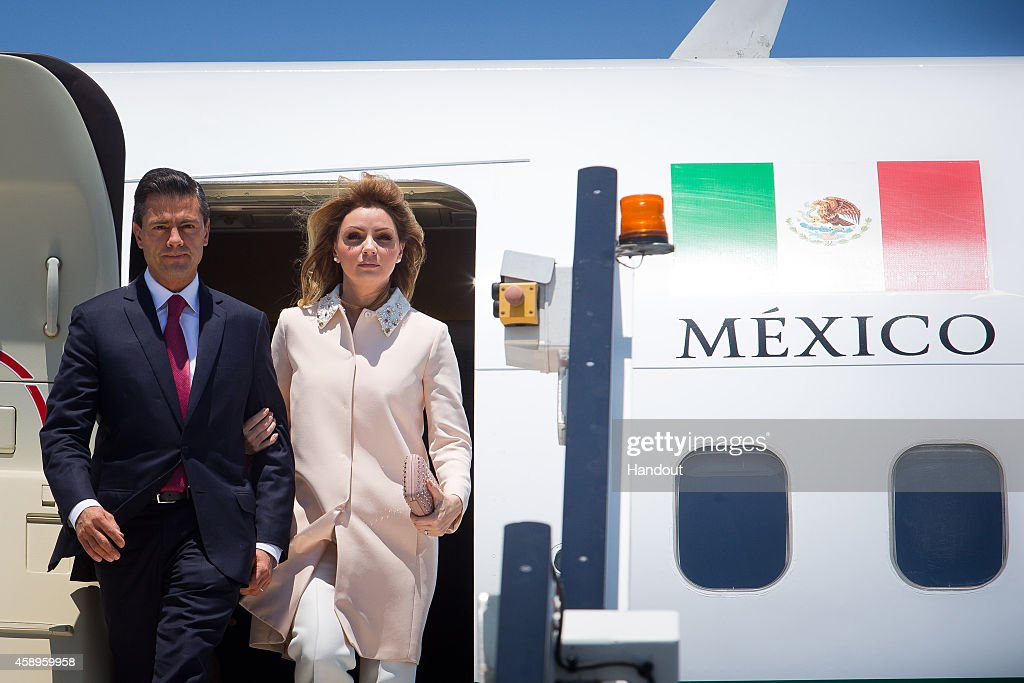 In this handout photo provided by the G20 Australia, Mexico's President Enrique Pena Nieto and First Lady Angelica Rivera Hurtado arrive at G20 Terminal on November 14, 2014 in Brisbane, Australia. World leaders have gathered in Brisbane for the annual G20 Summit and are expected to discuss economic growth, free trade and climate change as well as pressing issues including the situation in Ukraine and the Ebola crisis.