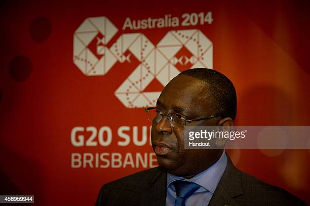In this handout photo provided by the G20 Australia Senegal's President Macky Sall arrives at the International Airport on November 14 2014 in...