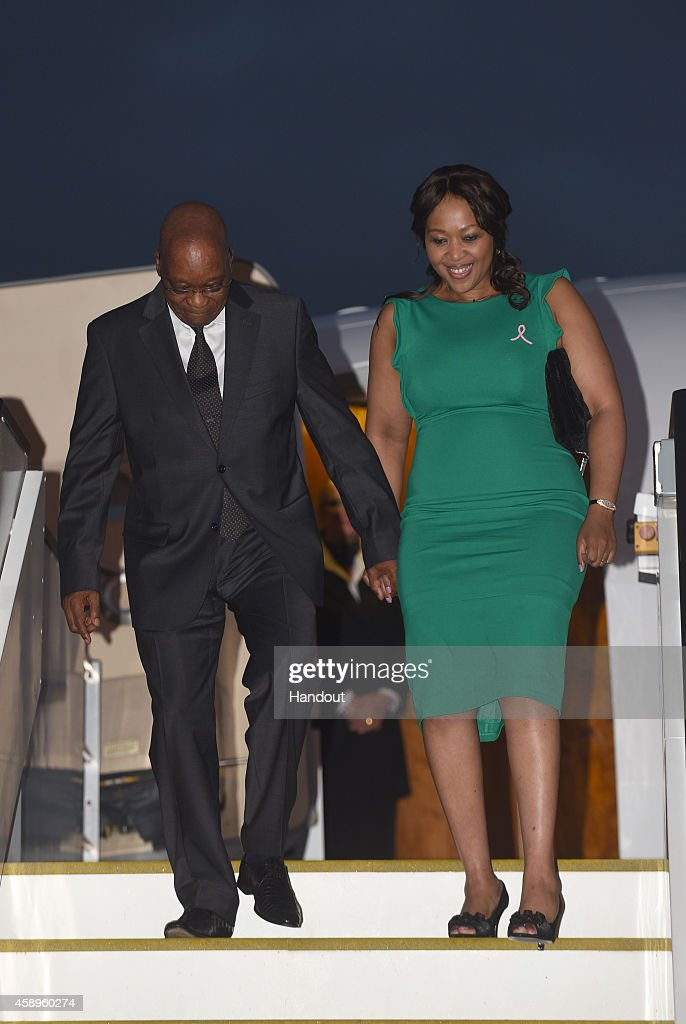In this handout photo provided by the G20 Australia, South Africa's president Jacob Zuma and his wife Tobeka Madiba-Zuma arrive at the G20 terminal on November 12, 2014 in Brisbane, Australia. World leaders have gathered in Brisbane for the annual G20 Summit and are expected to discuss economic growth, free trade and climate change as well as pressing issues including the situation in Ukraine and the Ebola crisis.