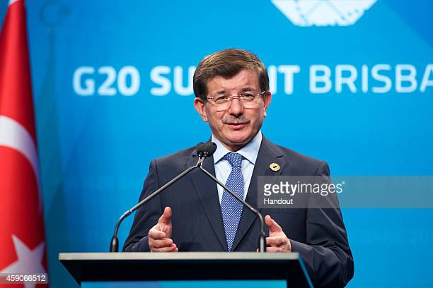In this handout photo provided by the G20 Australia Turkey's Prime Minister Ahmet Davutoglu addresses the media at a press conference at the...