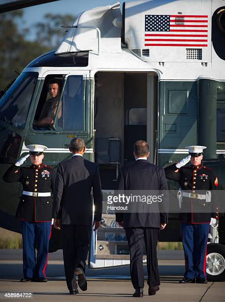 In this handout photo provided by the G20 Australia United States' President Barack Obama and US Ambassador John Berry is saluted by Marines at Royal...