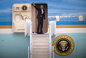 In this handout photo provided by the G20 Australia US President Barack Obama waves as he departs from Royal Australian Air Force's Base Amberley...