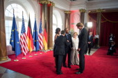 In this handout photo provided by the German Government Press Office US President Barack Obama and First Lady Michelle Obama stand alongside German...