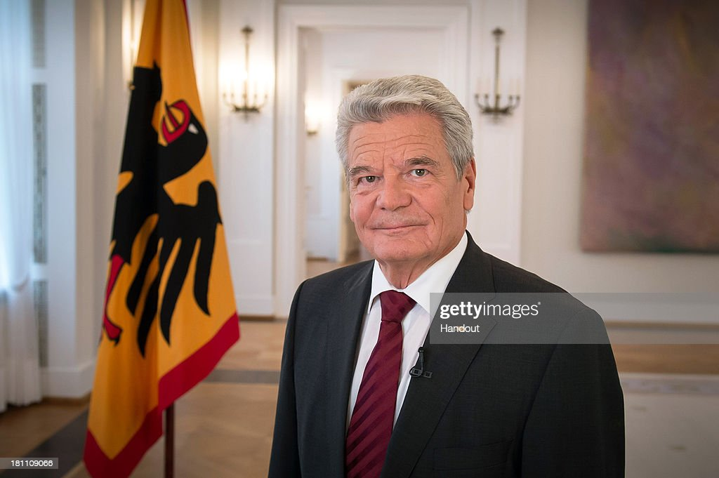 In this handout photo provided by the German Government Press Office (BPA), President <a gi-track='captionPersonalityLinkClicked' href=/galleries/search?phrase=Joachim+Gauck&family=editorial&specificpeople=2077888 ng-click='$event.stopPropagation()'>Joachim Gauck</a> poses during an election call for the 2013 German parliamentary elections, on September 18, 2013 at Schloss Bellevue, in Berlin, Germany. This is the final stretch of the German general elections, with no individual party having yet pulled out a lead in the polls.