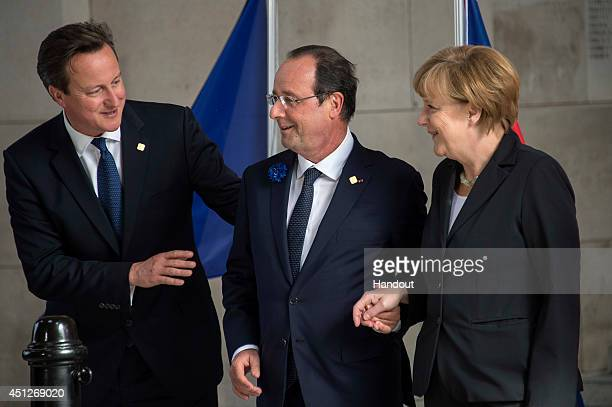In this handout photo provided by the German Government Press Office British Prime Minister David Cameron French President Francois Hollande and...