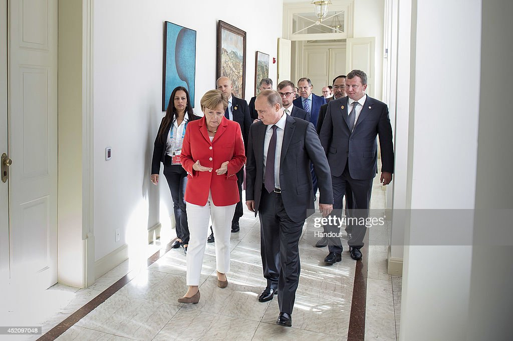 In this handout photo provided by the German Government Press Office (BPA), German Chancellor <a gi-track='captionPersonalityLinkClicked' href=/galleries/search?phrase=Angela+Merkel&family=editorial&specificpeople=202161 ng-click='$event.stopPropagation()'>Angela Merkel</a> meets Russian President <a gi-track='captionPersonalityLinkClicked' href=/galleries/search?phrase=Vladimir+Putin&family=editorial&specificpeople=154896 ng-click='$event.stopPropagation()'>Vladimir Putin</a> at Palacio Guanabara on July 13, 2014 in Rio de Janeiro, Brazil. Brazilian President Dilma Rousseff invited the heads of state ahead of the 2014 FIFA World Cup Brazil Final match between Germany and Argentina at Maracana.