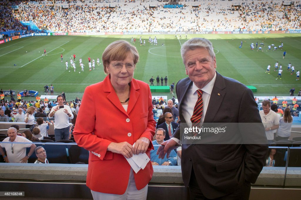 In this handout photo provided by the German Government Press Office (BPA), German Chancellor Angela Merkel and German President Joachim Gauck look on prior to the 2014 FIFA World Cup Brazil Final match between Germany and Argentina at Maracana on July 13, 2014 in Rio de Janeiro, Brazil.