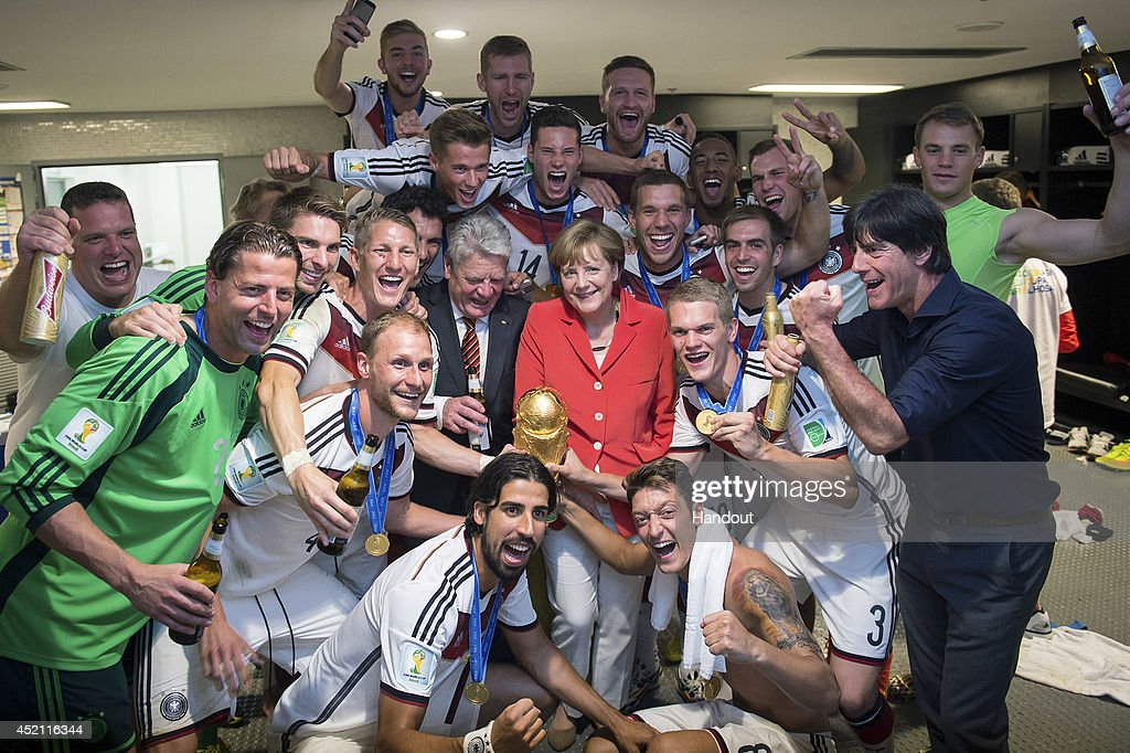 In this handout photo provided by the German Government Press Office (BPA), German Chancellor Angela Merkel and German President Joachim Gauck celebrate with the German national team after it's 1-0 victory in the 2014 FIFA World Cup Brazil Final match against Argentina at Maracana on July 13, 2014 in Rio de Janeiro, Brazil.