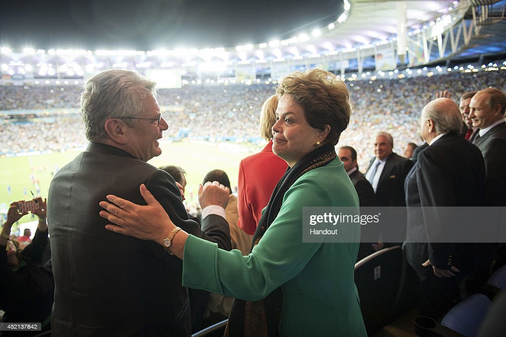 In this handout photo provided by the German Government Press Office (BPA), President of Brazil Dilma Rousseff congratulates German President Joachim Gauck after the 2014 FIFA World Cup Brazil Final match between Germany and Argentina at Maracana on July 13, 2014 in Rio de Janeiro, Brazil.