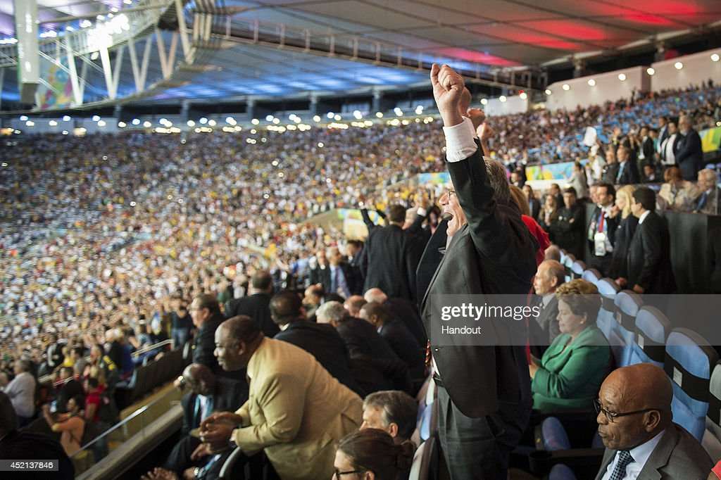 In this handout photo provided by the German Government Press Office (BPA), German President Joachim Gauck celebrates after the 2014 FIFA World Cup Brazil Final match between Germany and Argentina at Maracana on July 13, 2014 in Rio de Janeiro, Brazil.