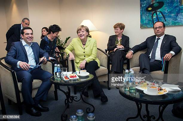 In this handout photo provided by the German Government Press Office German Chancellor Angela Merkel Greek Prime Minister Alexis Tsipras and French...