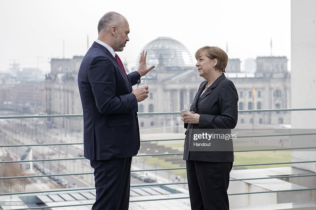 In this handout photo provided by the German Government Press Office (BPA), German Chancellor <a gi-track='captionPersonalityLinkClicked' href=/galleries/search?phrase=Angela+Merkel&family=editorial&specificpeople=202161 ng-click='$event.stopPropagation()'>Angela Merkel</a> (R) speaks with Albanian prime minister Edi Rama at the Chancellery on April 1, 2014 in Berlin, Germany. Rama will also meet with officials of the German parliament and businesses representatives. The meetings come before the EU decision to grant Albanian the candidate status.