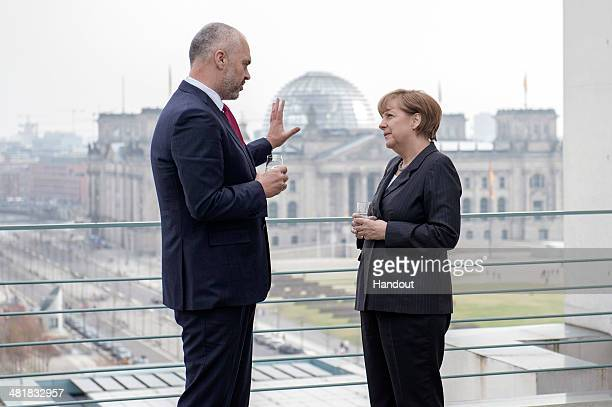 In this handout photo provided by the German Government Press Office German Chancellor Angela Merkel speaks with Albanian prime minister Edi Rama at...