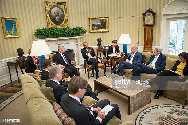 In this handout photo provided by the German Government Press Office US President Barack Obama and German President Joachim Gauck speak to Vice...
