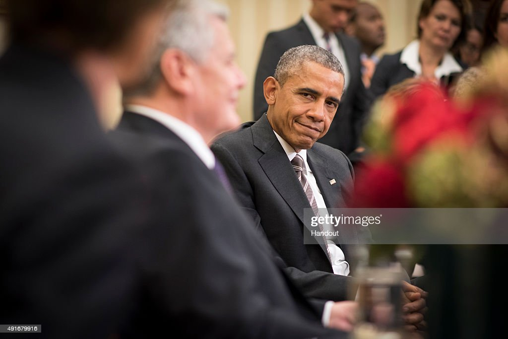 In this handout photo provided by the German Government Press Office (BPA), US President Barack Obama listens to German President Joachim Gauck (L) speak during a meeting in the Oval Office at the White House on October 7, 2015 in Washington, DC. The two leaders participated in a bi lateral meeting that marked the 25th anniversary of German reunification.