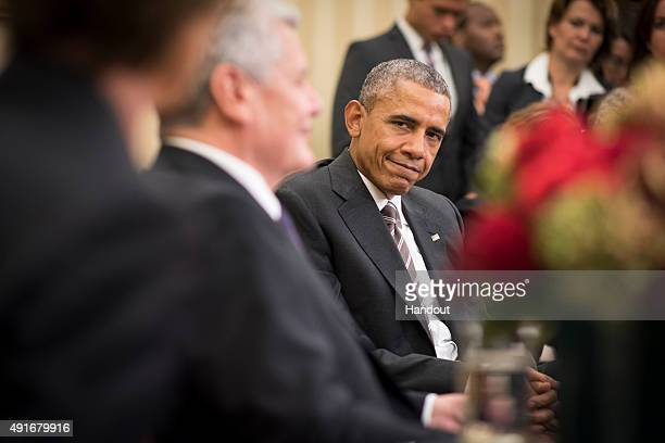 In this handout photo provided by the German Government Press Office US President Barack Obama listens to German President Joachim Gauck speak during...