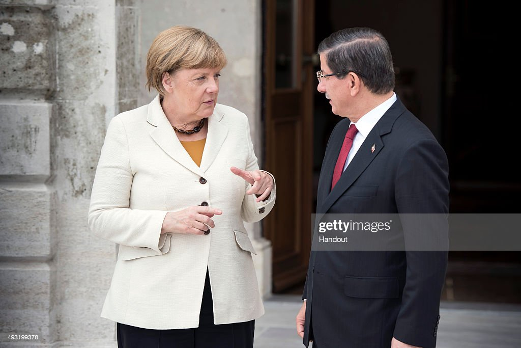 In this handout photo provided by the German Government Press Office (BPA), German Chancellor Angela Merkel and Turkish Prime Minister <a gi-track='captionPersonalityLinkClicked' href=/galleries/search?phrase=Ahmet+Davutoglu&family=editorial&specificpeople=4940018 ng-click='$event.stopPropagation()'>Ahmet Davutoglu</a> talk at the start of their meeting at the Dolmabahce Palace on October 18, 2015 in Istanbul, Turkey. Merkel is also due to meet Turkish President Recep Tayyip Erdogan.
