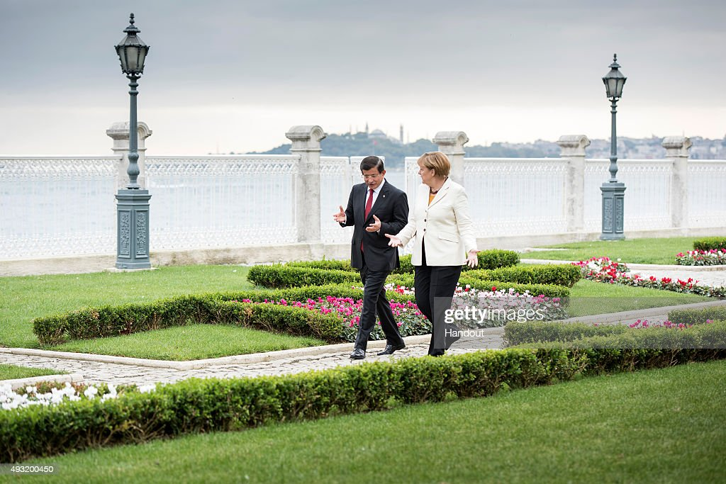 In this handout photo provided by the German Government Press Office (BPA), German Chancellor Angela Merkel and Turkish Prime Minister <a gi-track='captionPersonalityLinkClicked' href=/galleries/search?phrase=Ahmet+Davutoglu&family=editorial&specificpeople=4940018 ng-click='$event.stopPropagation()'>Ahmet Davutoglu</a> talk during their meeting at the Dolmabahce Palace on October 18, 2015 in Istanbul, Turkey. Merkel is also due to meet Turkish President Recep Tayyip Erdogan.