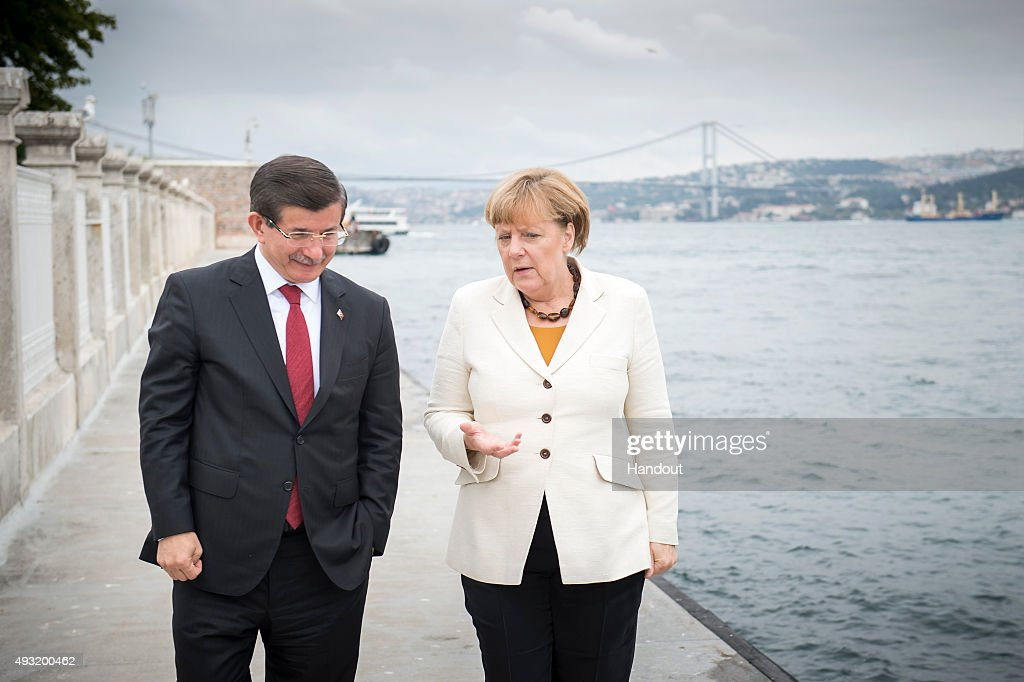 In this handout photo provided by the German Government Press Office (BPA), German Chancellor Angela Merkel and Turkish Prime Minister Ahmet Davutoglu talk walking at the Bosporus on October 18, 2015 in Istanbul, Turkey. Merkel is also due to meet Turkish President Recep Tayyip Erdogan.