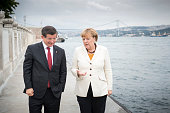 In this handout photo provided by the German Government Press Office German Chancellor Angela Merkel and Turkish Prime Minister Ahmet Davutoglu talk...