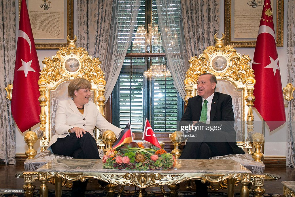 In this handout photo provided by the German Government Press Office (BPA), German Chancellor Angela Merkel and Turkish President Recep Tayyip Erdogan talk at the start of their meeting at the Yildiz Palace on October 18, 2015 in Istanbul, Turkey. Merkel also met Turkish Prime Minister Ahmet Davutoglu earlier today.