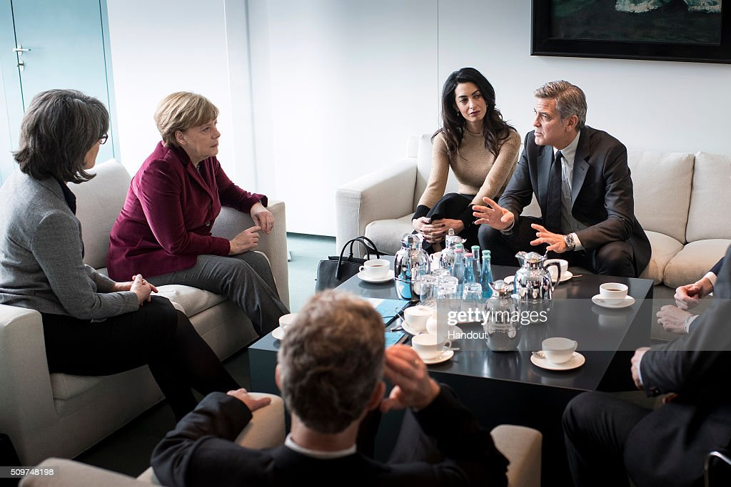 In this handout photo provided by the German Government Press Office (BPA) Chancellor Angela Merkel (2nd L) meets with <a gi-track='captionPersonalityLinkClicked' href=/galleries/search?phrase=George+Clooney&family=editorial&specificpeople=202529 ng-click='$event.stopPropagation()'>George Clooney</a> and Amal Clooney (2nd R) at the Federal Chancellery to talk about refugee policy and Germany's commitment to the International Rescue Committee, on February 12, 2016 in Berlin, Germany.