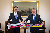 In this handout photo provided by the German Government Press Office German President Joachim Gauck and Polish President Andrzej Duda hold a match...