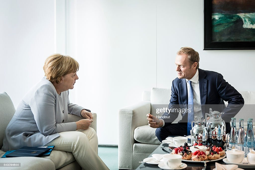 In this handout photo provided by the German Government Press Office (BPA) Chancellor <a gi-track='captionPersonalityLinkClicked' href=/galleries/search?phrase=Angela+Merkel&family=editorial&specificpeople=202161 ng-click='$event.stopPropagation()'>Angela Merkel</a> speaks with the EU Council President Donald Tusk four days after the Brexit vote was confirmed in the United Kingdom in her office in the Berlin Chancellery on June 27, 2015 in Berlin, Germany.
