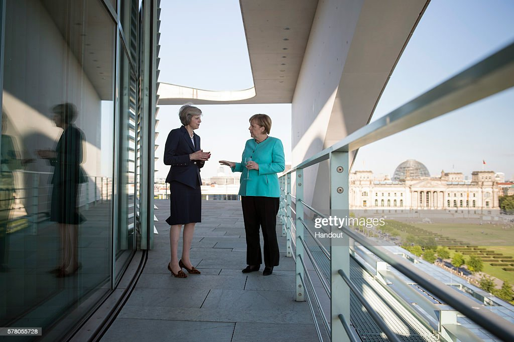 In this handout photo provided by the German Government Press Office (BPA), German Chancellor Angela Merkel and British Prime Minister Theresa May talk during their meeting at the Chancellery on July 20, 2016 in Berlin, Germany. The two leaders discussed their upcoming cooperation together as well as the United Kingdom's withdrawing of its membership from the European Union, known as Brexit.