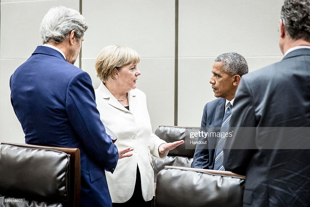 In this handout photo provided by the German Government Press Office (BPA), German chancellor Angela Merkel speaks with US President Barack Obama (L) and US Secretary of State John Kerry (L) on the sidelines of the G20 meeting on September 5, 2016 in Hangzhou, China. World leaders are gathering for the 11th G20 Summit from September 4-5.